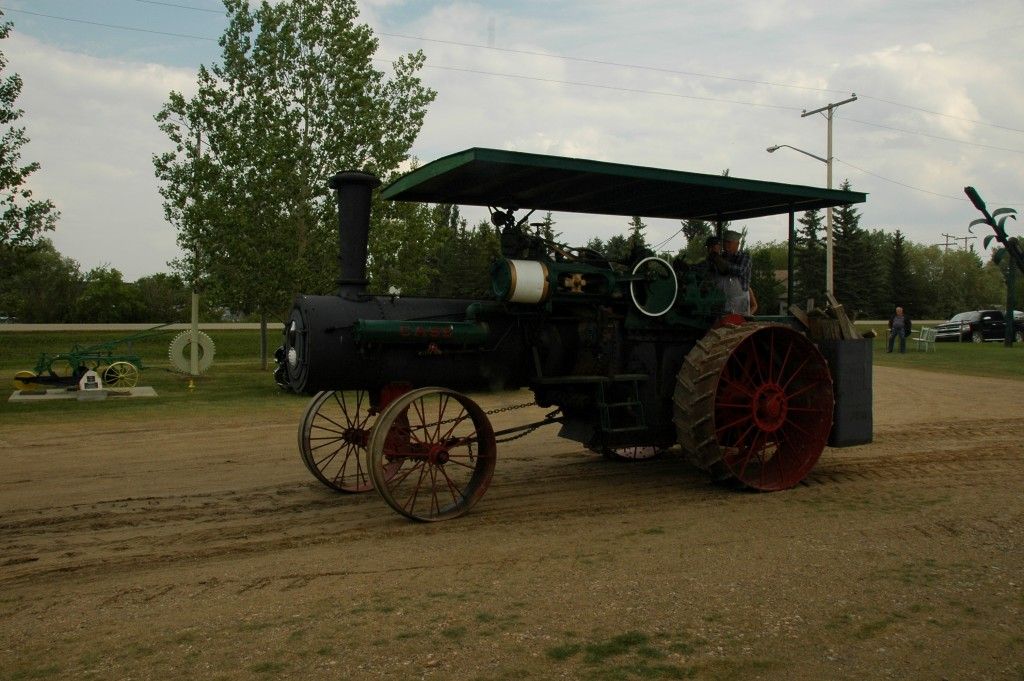 A steam-powered tractor evokes pioneer culture at the Deep South Pioneer Museum Day parade. July 5, 2015. Photo: Kristin Catherwood